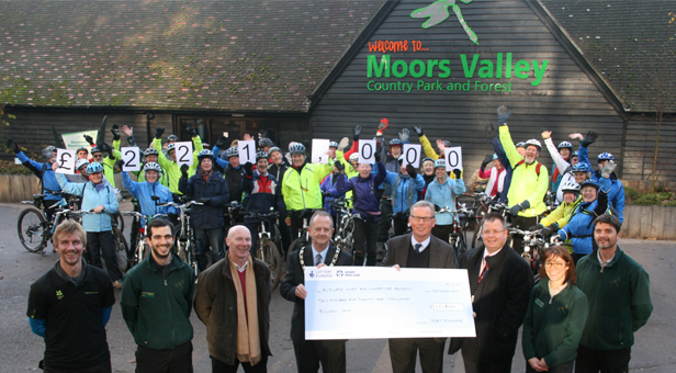 Cyclists at Moors Valley Country Park with (at the front from left to right) Rob Greenhalgh from Kingston Lacy, Karl Prince from Moors Valley, Tony Jones-Pert from Active Dorset, Cllr Malcolm Birr Chairman of East Dorset District Council, Jim Barrett from Sport England, Dave Franks from Dorset County Council, Jackie O'Connor and Marc Thompson from Moors Valley.