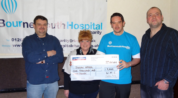 Stephen Bargery, right, with Bournemouth Hospital Charity Fundraising Officer Barry Wilson and members of the Wimborne Mower Club.