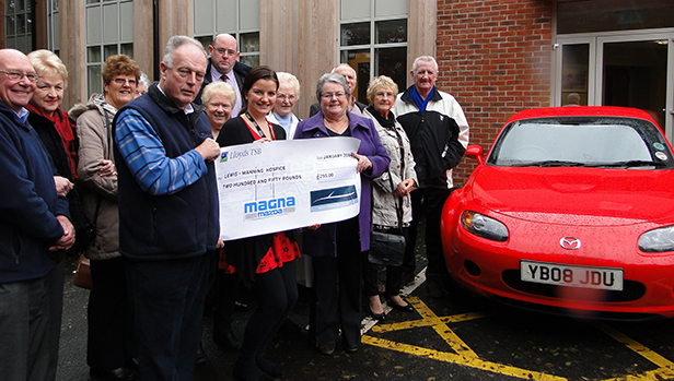 Mazda MX-5 Owners Club present Sara Johnson from Lewis-Manning Hospice with cheque