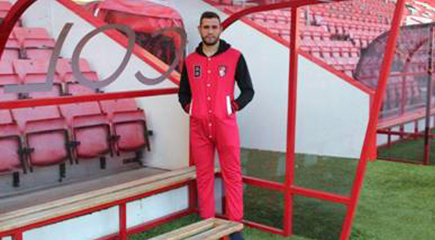 Steve Cook, Central Defender, AFC Bournemouth's First Team wearing an AFC Bournemouth branded onesie