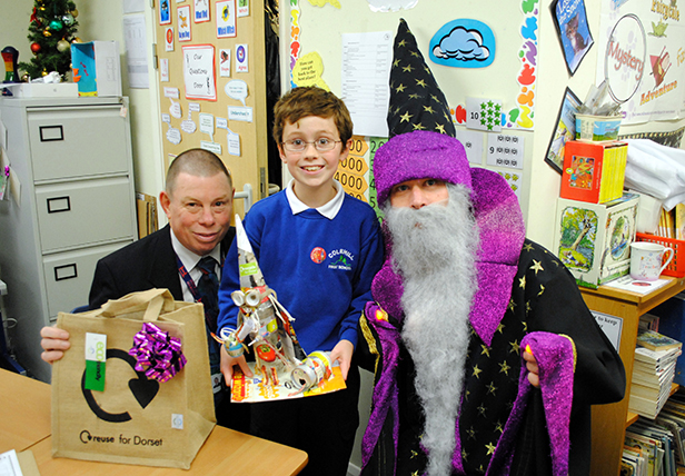 Joe receiving his prize from Cllr Steve Butler and Walter the Waste Wizard
