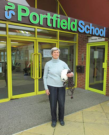 Photo of Joan Dampney outside Portfield School