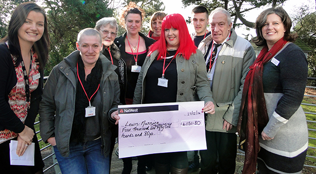 Stacey Turner (centre with cheque) with Ty's family and friends presenting Lewis-Manning with cheque