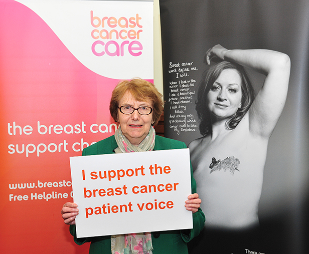 """MP Annette Brooke holding sign saying """"I support breast cancer patient voice"""""""