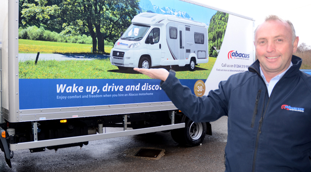 Dave Wolfenden with one of the Motorhome Hire promotional trucks.