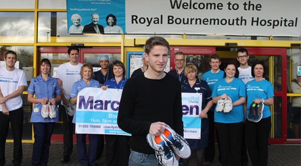 AFC Bournemouth footballer Eunan O'Kane with staff from the Royal Bournemouth Hospital and Bournemouth Hospital Charity.