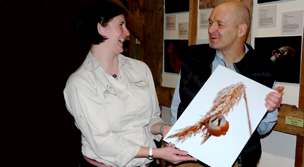 Katie Davies, Countryside Interpretation Ranger at Moors Valley Country Park with Tony Moss and his highly commended image
