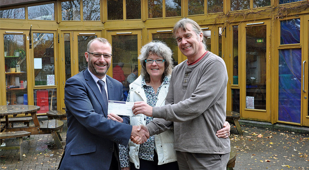 Surprise win: Richard Barton, SBW's Customer Services Manager (left) presents a £500 cheque to Gill Redmond and Pete Gritton.