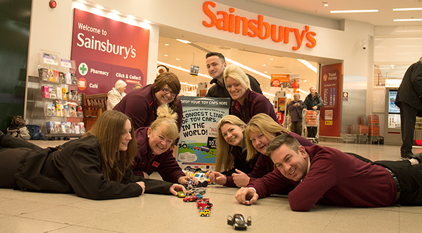 Staff at Sainsbury's with toy cars