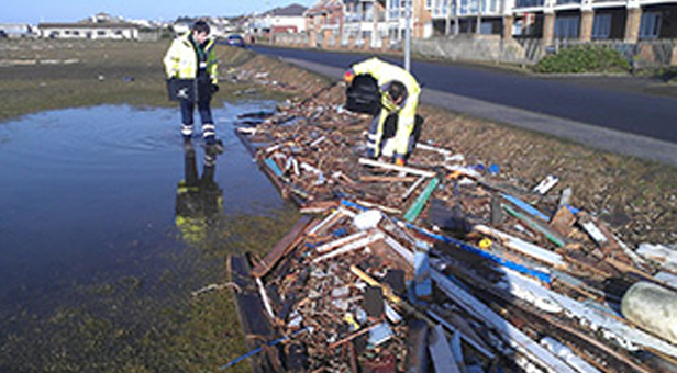 Teams clearing debris