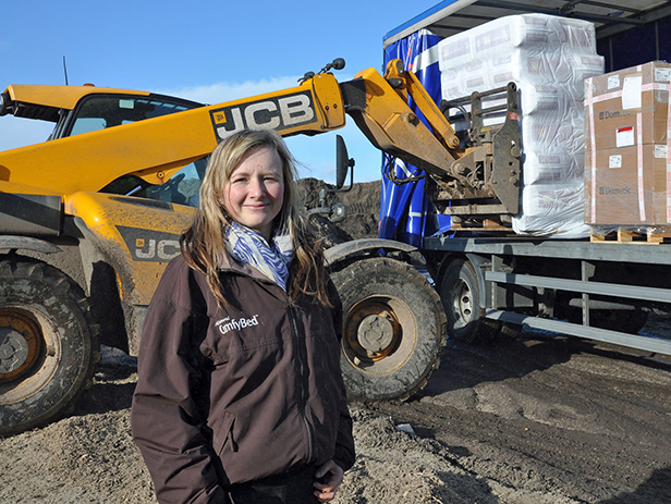 Account manager Mel Western supervises the loading of 60 bales of Eco ComfyBed