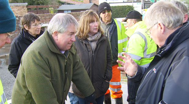 Bob Walter MP (L) and District Councillor Jane Somper (C) inspect the drainage system at Milborne St Andrew with local Flood Warden Steve Lord (R)