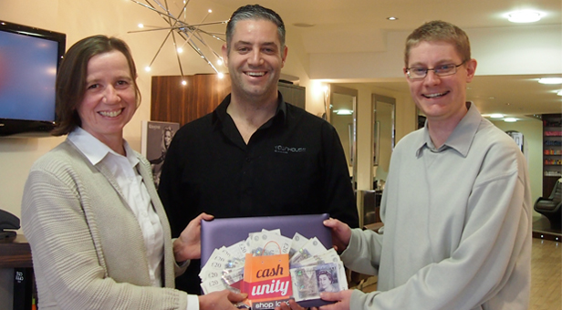 SMILES ALL ROUND: Tracey Miller receives £1000 cash prize from director of mags4dorset Ben Pulford (right) with participating trader Paul Bryant, Townhouse Hair Salon, Ringwood (centre).