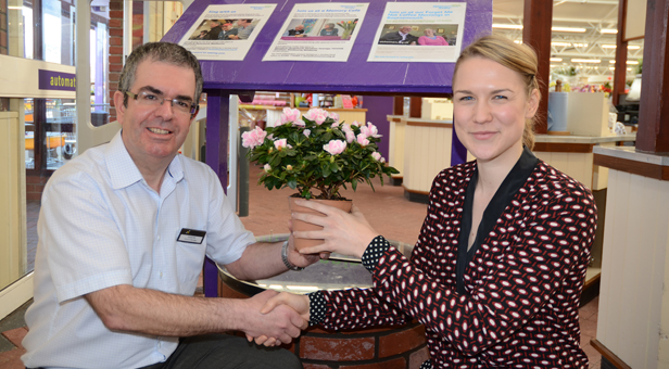 Simon Morris presents Rachael Sweet a plant for auction by the Centre's Charity Wishing Well.