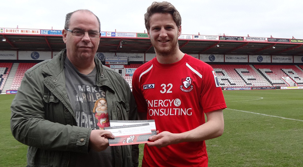 AFC Bournemouth footballer Eunan O'Kane awarding fundraiser Dave Coleman with tickets to see AFC Bournemouth