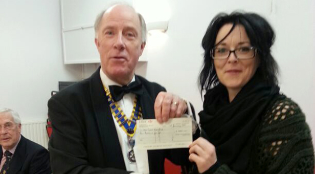 Rotary President Michael Lingam-Willgoss presents cheque to Jude Todd, Co-ordinator of Nightstop