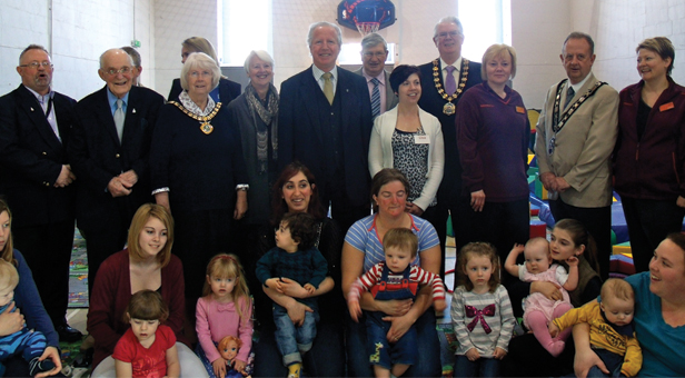 Dignitaries pose with organiser, mums and tots for a photograph