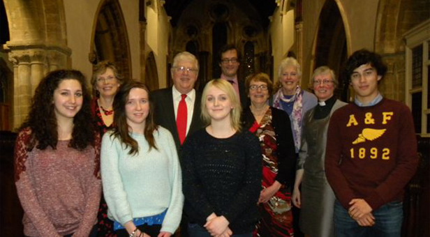 Robert Key (with red tie), Flick and David Warwick, (2nd left behind and centre back) and Liz Watson (3rd from right next to the Rector) with the Rector and Annette Brooke plus four students from Corfe Hills School