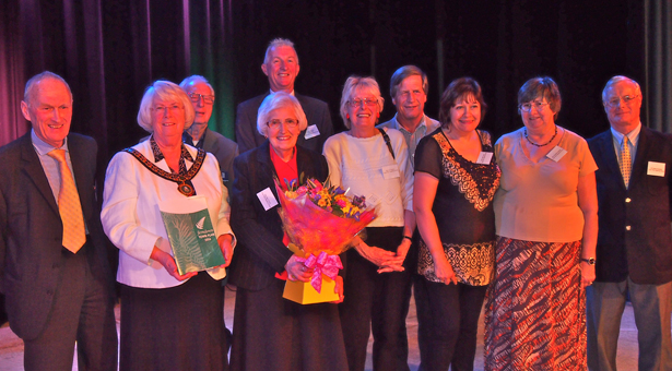in no particular order: Terry Cordery, The Mayor Cllr Mrs Pauline Reynolds holding the town plan, Jean Turner (with flowers), Lynn Ovens, Cathy Lugg, Christine Coleman, George Berger, Ron Tomlin, David Parkinson and Kevin Moore