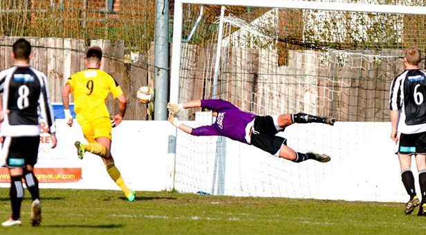 Wimborne goalkeeper Jason Harvell denies North Leigh an equaliser © Simon Carlton