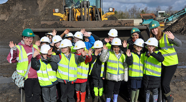 Dig this: Pupils from St Mary's Catholic Primary School in Poole enjoy their visit to Eco's Parley site with class teacher Susy Ngadeu (left) and Eco's Charlotte Haswell (right).