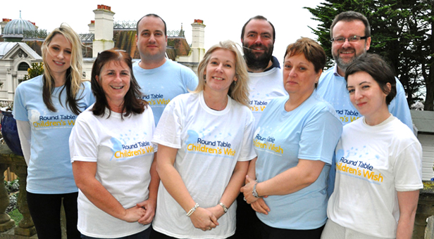 Round Table Children's Wish Director Karen Winchcombe, centre, with staff and trustees in wearing T-shirts with the new design on.