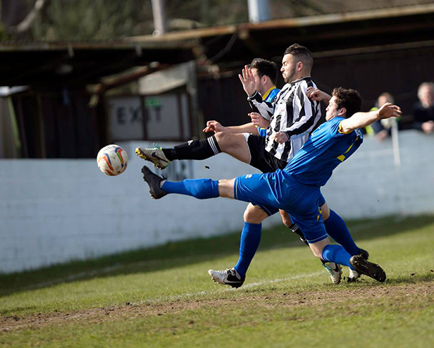 Action shot from Wimborne's game against Paulton at Cuthbury