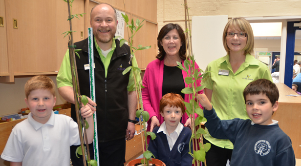 (Front from left) Beanstalk competition winners Tyler, Rebecca, and Tom with (Top L - R) Haskin's David Brown, Head Teacher Hilary Silk and Joolz Walford