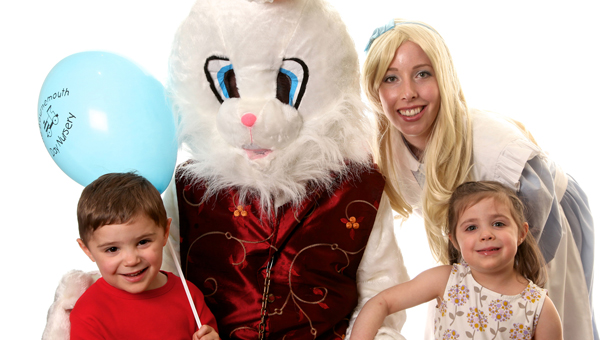 Model twins Woody and Gisele Saunders with characters from Alice in Wonderland. Photo by Millard Photography.