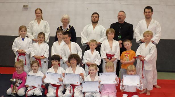 Mini Jitsu group with Hatamoto Sensei John Hanrahan, Mayor of Ferndown Cllr Pauline Reynolds, Sensei Rob Hanrahan and Katie Dudley