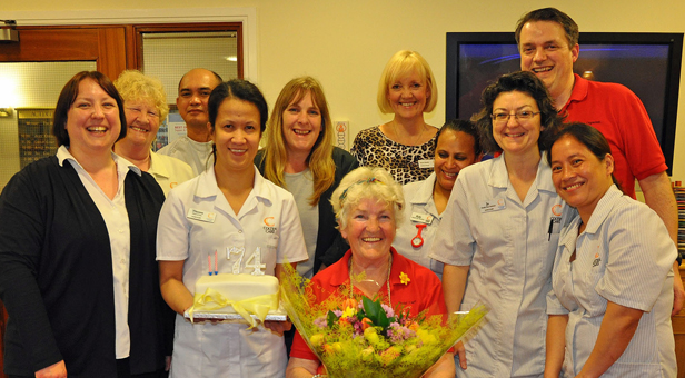 Fond farewell: Staff at Colten Care's Avon Cliff home in Bournemouth mark social carer Maureen Ross' retirement.