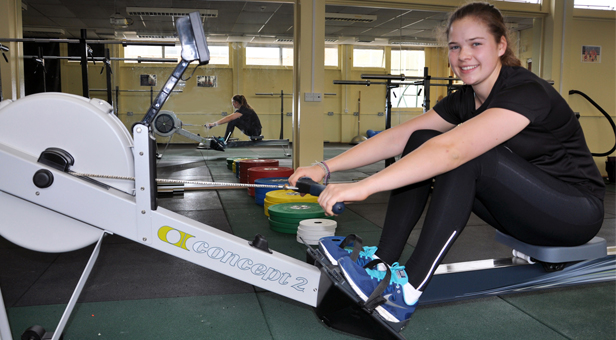Lizzie Lander training on an indoor machine at her school, the LeAF Studio in Bournemouth