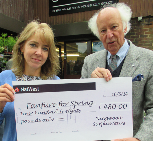 Pictured Nicki Foaks of Ringwood Surplus Stores presenting cheque to Roger Bettle organiser of Fanfare for Ringwood