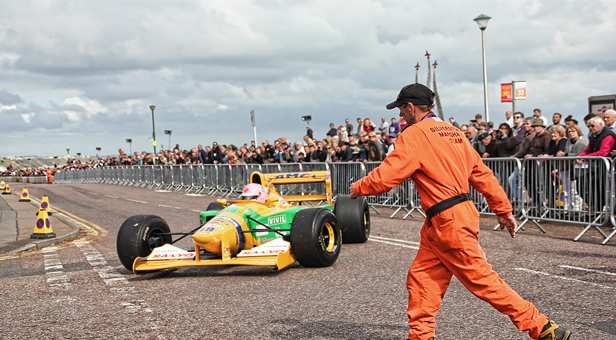 Crowds gathered to see the Formula 1 Benetton Grand Prix car (from the 1990s) at East Overcliff Drive © Kay Browning