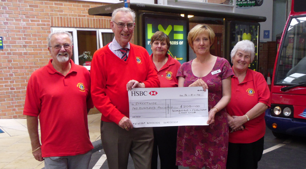 Barry Duxbury, Anne Lippitt and Joan Budden with Ken Taylor handing the cheque to Diana