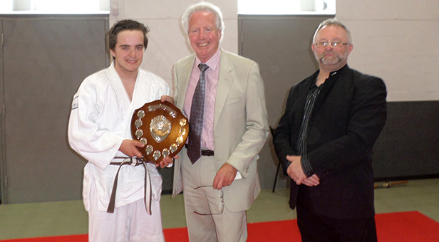 Sensei Jordan Lea receiving the Charlotte Read Award for Endeavour in 2014 at Ferndown Jitsu Club from HM Lord Lieutenant of Dorset Angus Campbell and Hatamoto Sensei John Hanrahan