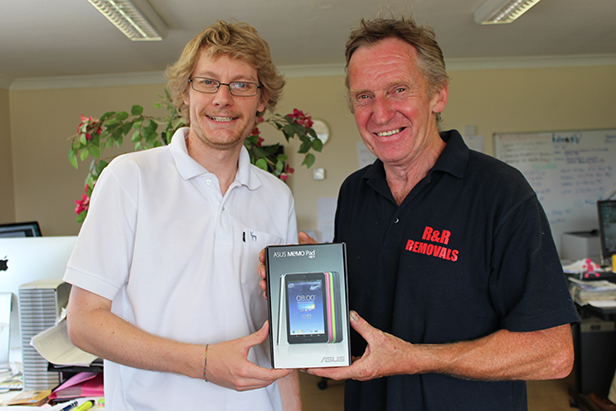 David Clark (right) collects his prize of an Asus Memo Pad from mags4dorset's Ben Pulford