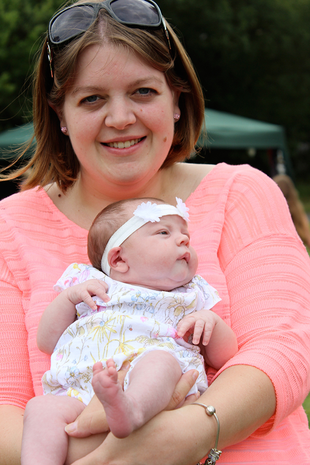 Little sweetie: Poppy is only 3 weeks old, seen here with her mother Kirsty Wyatt