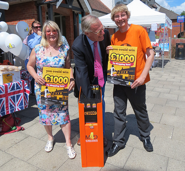 Christchurch MP Chris Chope draws the winner, pictured with mags4dorset directors Janine Pulford and Ben Pulford