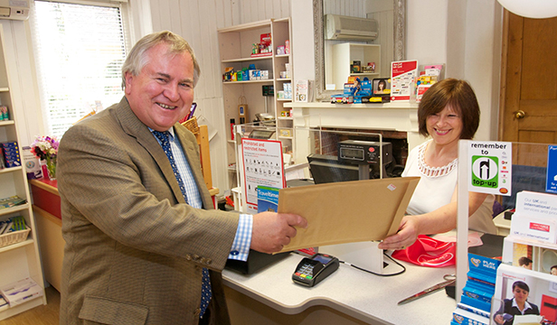 Bob Walter MP sends his first letter at the refurbished Fontmell Magna PO, with the help of Postmaster Jan Attfield