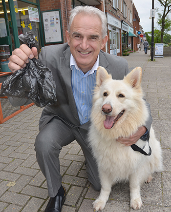 Steve Fowler with his 4 year old German Shepherd Izzy hopes people will pick up the free poop bags