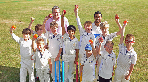 Bowled over: Princecroft Willis Partner James Robinson (back left) and Head Coach Badrul Alam with members of Poole Town Cricket Club's youth section