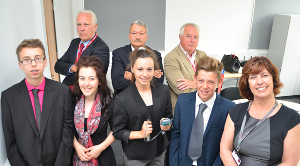 (rear from left) Dragons Danny Godfrey, Peter Matthews, John Knowles with contestants (front from left) Danny Gunn, Alice Keeble and winner Libbie Sinclair, Ben Keeble and head of business studies Caroline Kurtulan