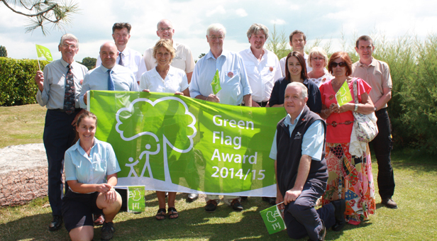 Representatives from Borough of Poole celebrating Poole Park's Green Flag
