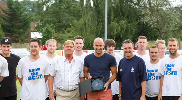 Paul Roast receives a presentation before the start of Saturday's game against AFC Bournemouth flanked by Chairman Ken Stewart (l) manager Steve Cuss (r) and members of the squad. © Simon Carlton