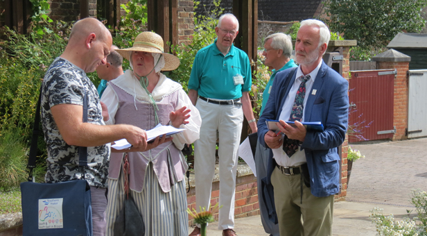 Judges Matt Wakefield (left) and Derrek Donnison-Morgan are shown round the Physic Garden by Denise Colling