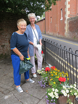 Volunteers Ann Sheldrake (left) and Olive Glancy were out early doing some last minute tidying up