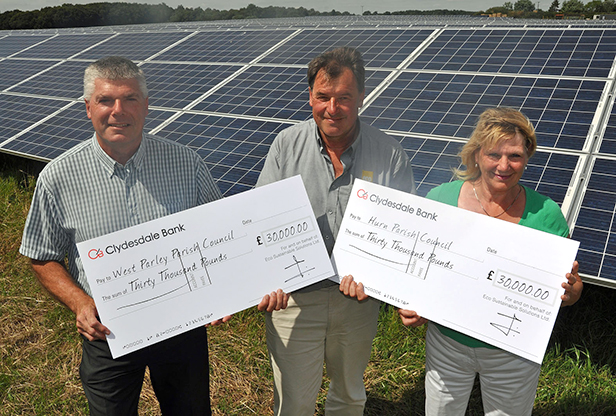 Trelawney Dampney, Eco's Managing Director (centre) presents the £30,000 cheques to John Cullen, Chairman of West Parley Parish Council, and Margaret Phipps, Chairman of Hurn Parish Council