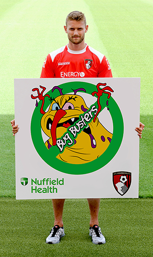 AFC Bournemouth's Simon Francis with Bug Busters poster