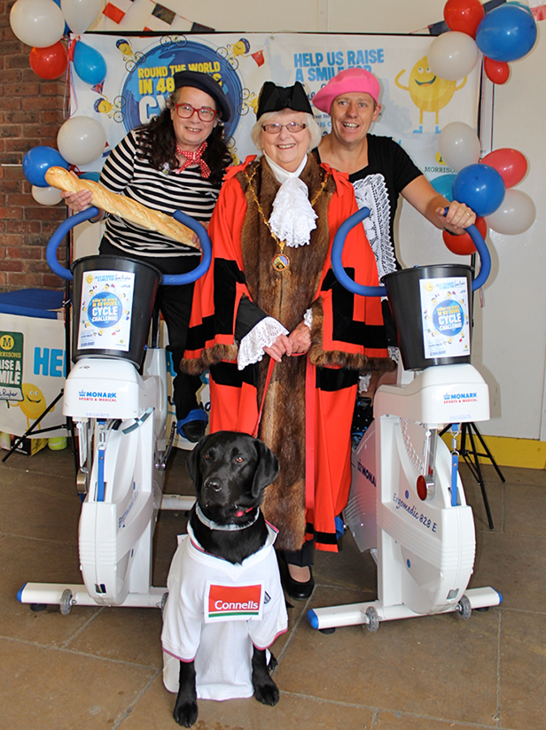 Morrisons community champion Jenny Cook with the Mayor of Verwood, deputy store manager John Camish and Henri